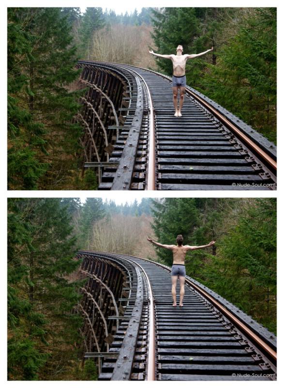 Male model art in boxer-briefs upon train rails